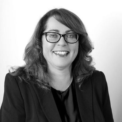 Black and white photo of Partner Sarah Carr