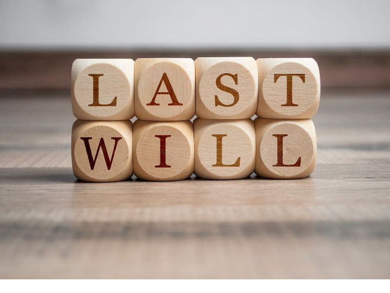 Wooden blocks spelling out LAST WILL